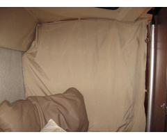 Forward berth privacy curtain