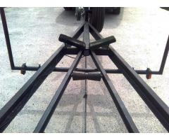 Bow roller, reinforcement and side guides