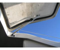 Forward Hatch Adjuster