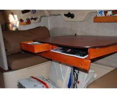 Chart Storage and drawer under setee table