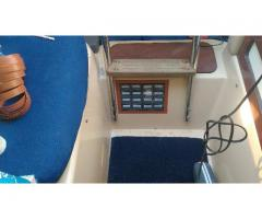 Small drawers under the companionway ladder