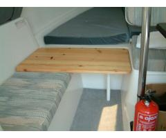 Extended V-berth and cockpit-table